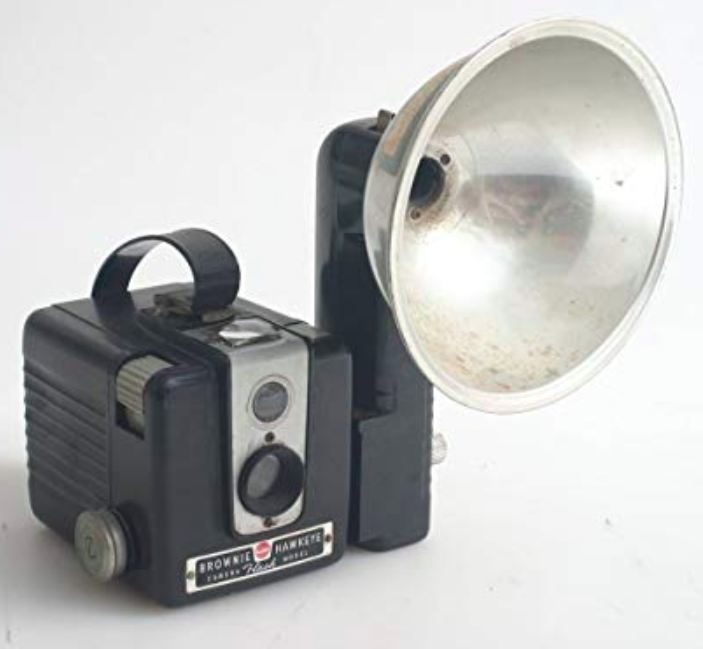 Old camera with a flash